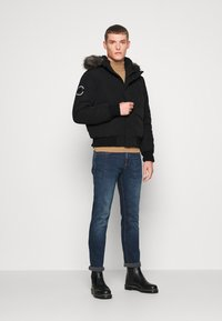 Superdry - EVEREST - Winter jacket - black - 1