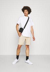 Carhartt WIP - SCRIPT EMBROIDERY - Basic T-shirt - white/black - 1