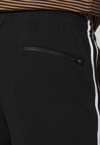 Lacoste - Tracksuit bottoms - black/white - 5