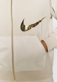 Nike Sportswear - Zip-up hoodie - oatmeal/metallic gold
