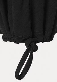 Curare Yogawear - PANTS SKIRT - Teplákové kalhoty - black - 5
