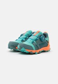 adidas Performance - TERREX  AGRAVIC BOA R.RDY UNISEX - Hiking shoes - hazy emerald/acid mint/screaming orange - 1