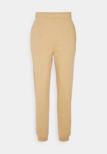 RILEY JOGGER - Tracksuit bottoms - beige / karamell