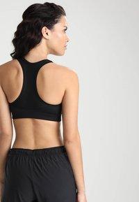 Casall - ICONIC SPORTS BRA - Medium support sports bra - black - 2
