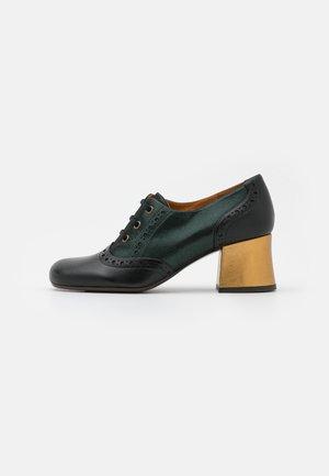 MICUCA - Lace-up heels - metallic green
