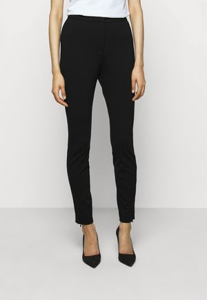 HENIAS - Leggings - Trousers - black