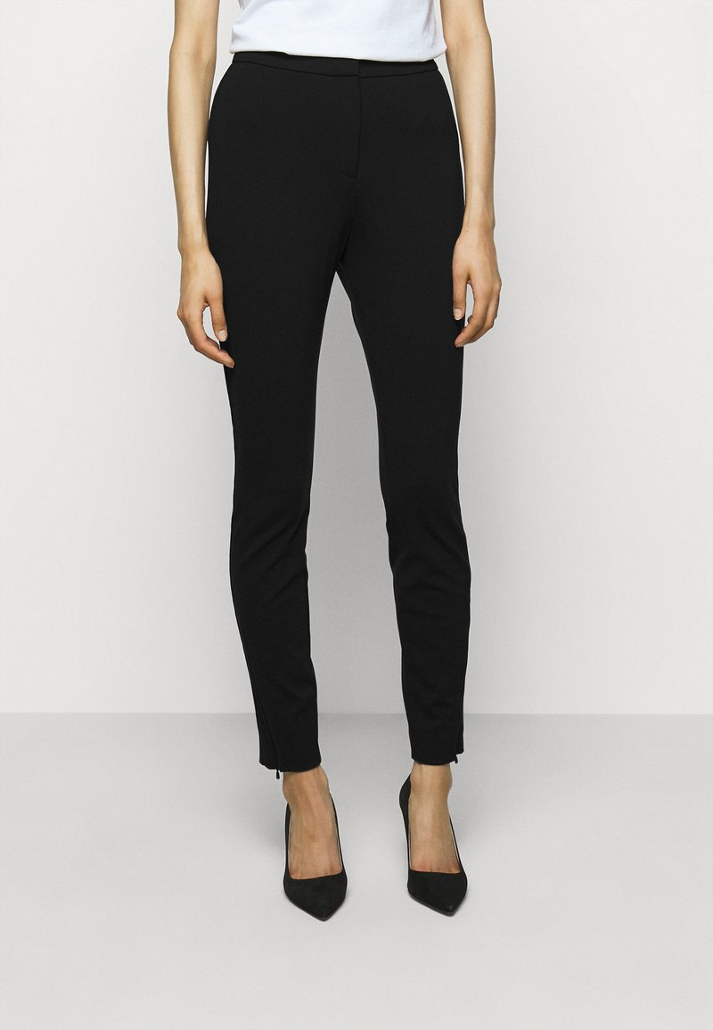 HUGO - HENIAS - Leggings - Trousers - black