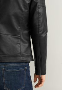 Mango - JOSENO - Faux leather jacket - black - 4