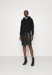 Calvin Klein Jeans - ECO HOODIE - Hoodie - black - 1