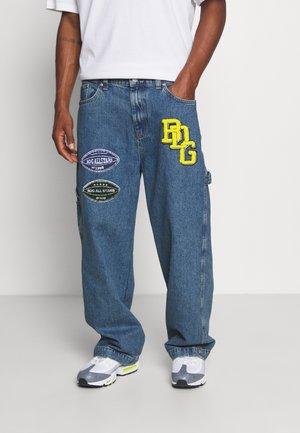 CARPENTER JACK BADGE - Relaxed fit jeans - denim