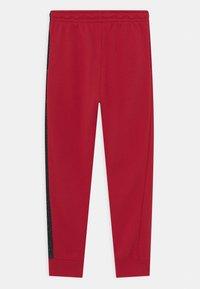 Jordan - AIR SPECKLE PANTS - Tracksuit bottoms - gym red - 1