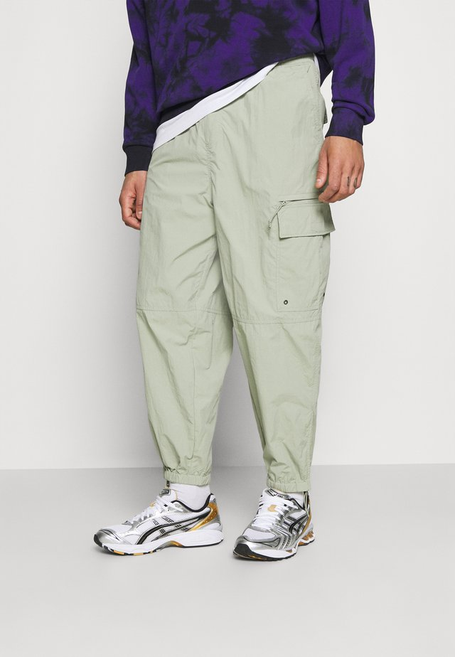 SCOTTIE BAGGY JOGGERS UNISEX - Trainingsbroek - light khaki green