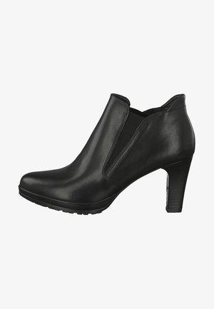STIEFELETTE - Kotníková obuv - black