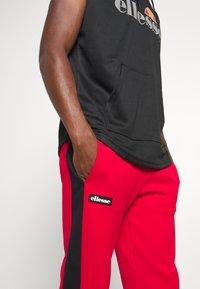 Ellesse - POTAT - Teplákové kalhoty - red - 3