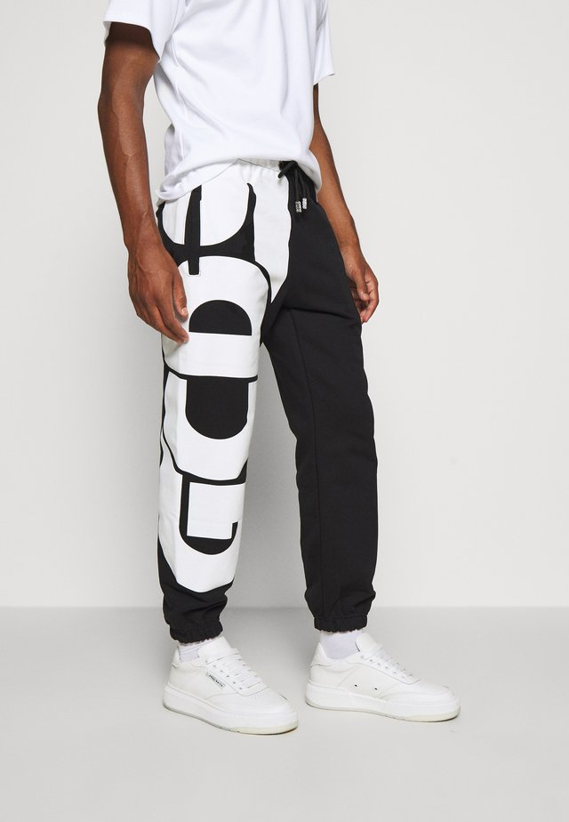 MACRO LOGO  - Tracksuit bottoms - black