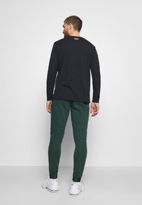 Under Armour - ROCK PANT - Tracksuit bottoms - ivy - 2