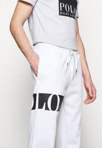 Polo Ralph Lauren - DOUBLE TECH - Tracksuit bottoms - white - 4