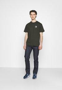 Nudie Jeans - GRITTY JACKSON - Straight leg -farkut - dark blue denim - 1