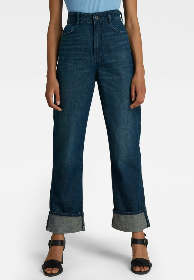 TEDIE ULTRA HIGH STRAIGHT - Jeans a zampa - worn in atoll blue