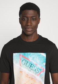 Guess - WATERLINE TEE - Print T-shirt - jet black - 3