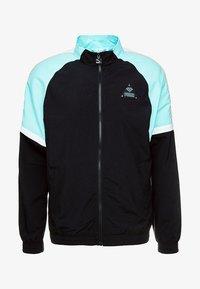 Puma - DIAMOND TRACK TOP - Training jacket - black - 3