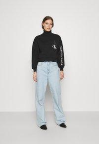 Calvin Klein Jeans - ROLL NECK - Mikina - black - 1