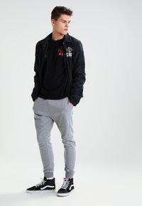 YOURTURN - Pantalones deportivos - mottled grey - 1