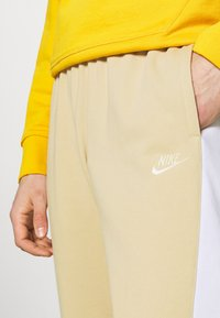 Nike Sportswear - Tracksuit bottoms - grain/white/coconut milk - 4