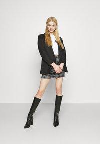 New Look - CHAIN MINI SKIRT - Mini skirt - black - 1
