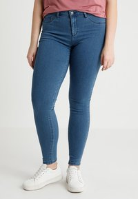 ONLY Carmakoma - CARTHUNDER PUSH UP - Jeans Skinny Fit - medium blue denim - 0