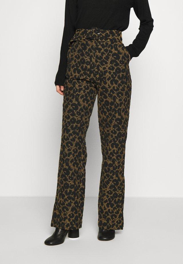 CARA - Trousers - black