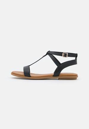 FEMININE FLAT - Sandals - black