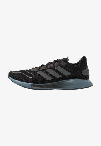 GALAXAR RUN - Neutral running shoes - core black/blue