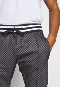 Night Addict - Tracksuit bottoms - grey/black - 4