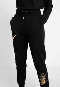 Nike Sportswear - SHINE - Tracksuit bottoms - black/metallic - 6