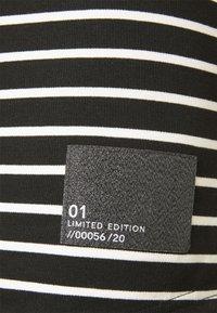 Kids ONLY - PATCH - Jersey dress - black - 2