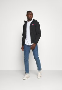 Tommy Jeans - PADDED JACKET - Light jacket - black - 1