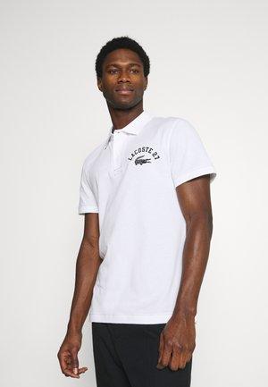 Poloshirt - blanc