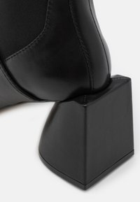 N°21 - BOOTIES - Classic ankle boots - black - 4