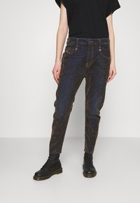 Diesel - FAYZA - Relaxed fit jeans - military green - 0