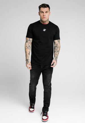 Vaqueros slim fit - washed black