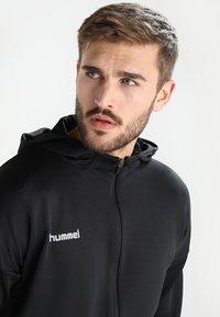 Hummel - TECH MOVE ZIP HOOD - Training jacket - black - 3