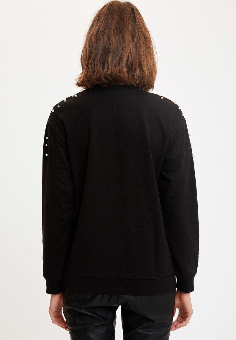 DeFacto Sweatshirt - black/schwarz wLN76G