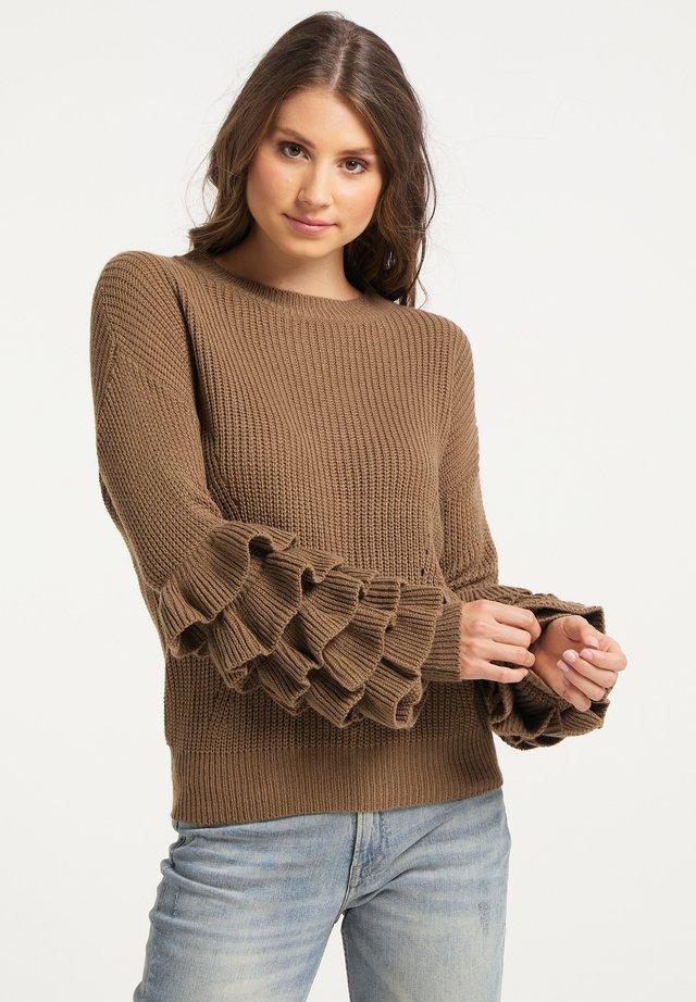 Stickad tröja - dunkelcamel