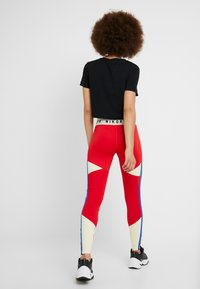 Nike Sportswear - Leggings - Trousers - university red/white - 2