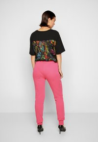 Versace Jeans Couture - PANTS - Tracksuit bottoms - pink - 3