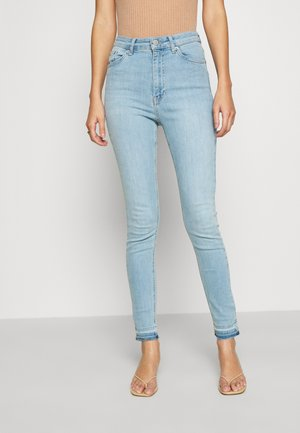 SKINNY HIGH WAIST OPEN HEM - Jeans Skinny Fit - light blue