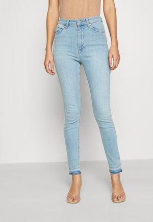 SKINNY HIGH WAIST OPEN HEM - Skinny džíny - light blue