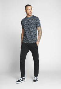Replay - Tracksuit bottoms - black - 1