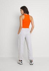 Weekday - ALISA PANTS - Pantalon de survêtement - grey melange - 2